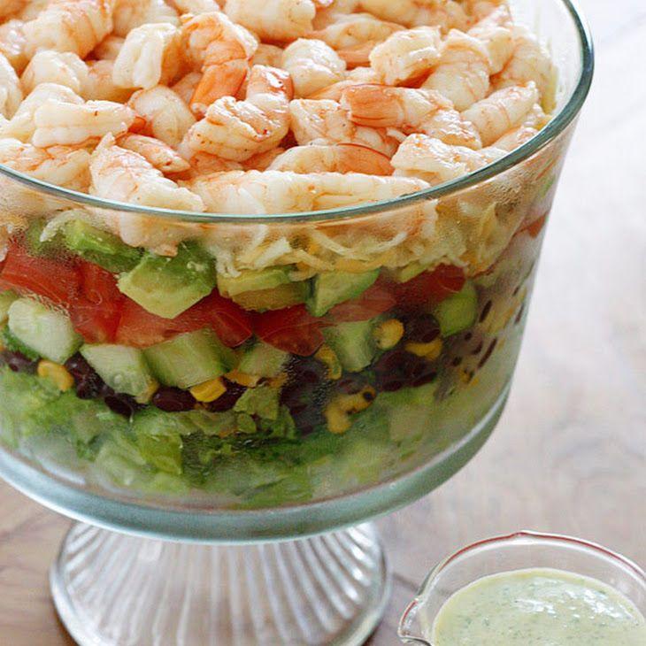 Mexican Shrimp Cobb Salad Recipe Salads with large shrimp, chili powder, lime juice, salt, romaine lettuce, black beans, corn kernels, purple onion, cilantro, lime, seedless cucumber, diced tomatoes, hass avocado, shredded cheese