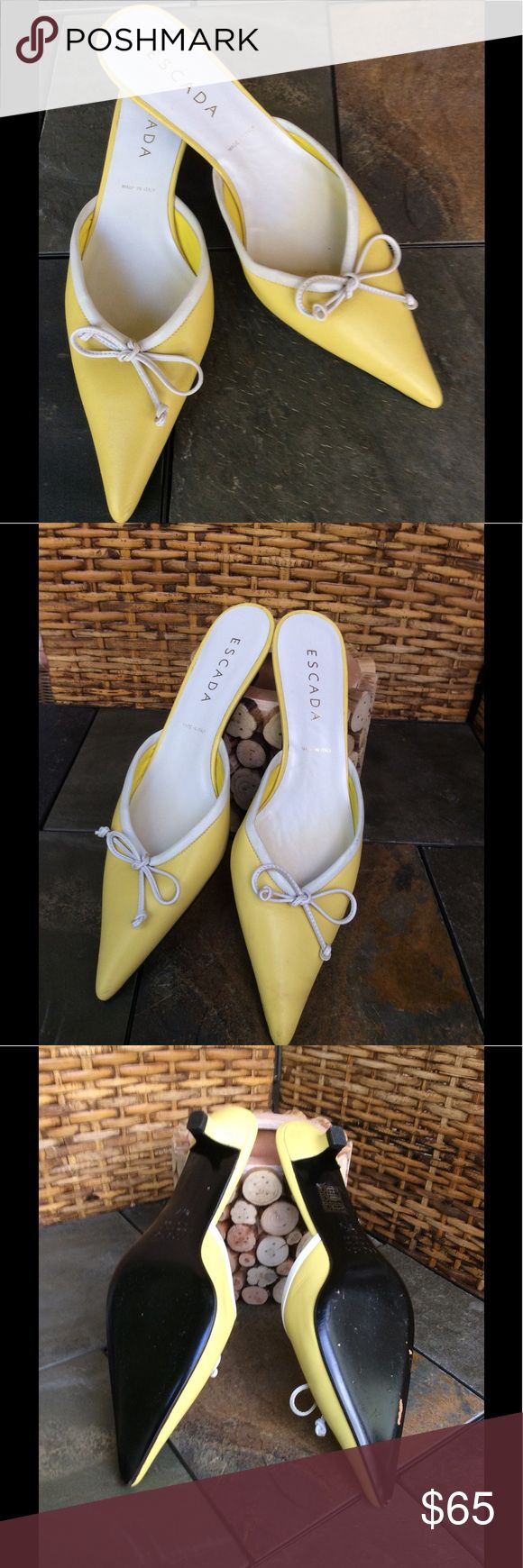 GORGEOUS ESCADA ITALIAN LEATHER SHOES WITH BOW  THESE DESIGNER GORGEOUS ITALIAN LEATHER SHOES ARE TO DIE FOR. SLIP THEM ON AND BE STYLISH AND COMFORTABLE. MADE IN ITALY.  LOVELY YELLOW WITH SOME WHITE TRIM AND A WHITE BOW. YOU ARE GOING TO LOVE ❤️ THESE SHOES. ESCADA Shoes Heels
