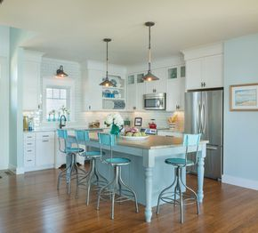 Gorgeous le creuset tea kettle in Kitchen Beach Style with Coastal Kitchen next to Baseboard Molding alongside Faux Travertine Porcelain Tile and Light Blue Walls