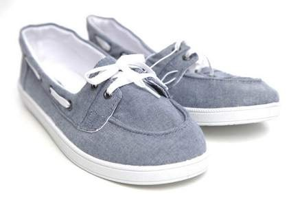 Coast into work with a pair of chambray boat shoes, lined with bright white bottoms and laces. This preppy option is easy to dress up or down. Or, get sassy with the same shoe, below, in a fiery red. Chambray boat shoes, $14.99 at Target, various locations.