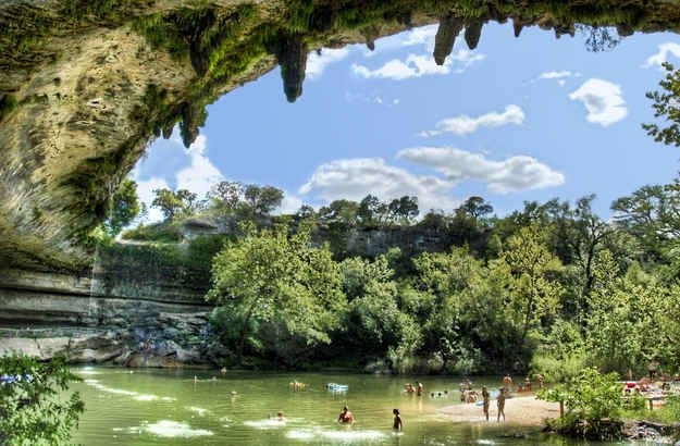 Pack a picnic and head to gorgeous natural swimming grotto Hamilton Pool. | 35 Things Everyone Should Do In Austin, Texas, Before They Die