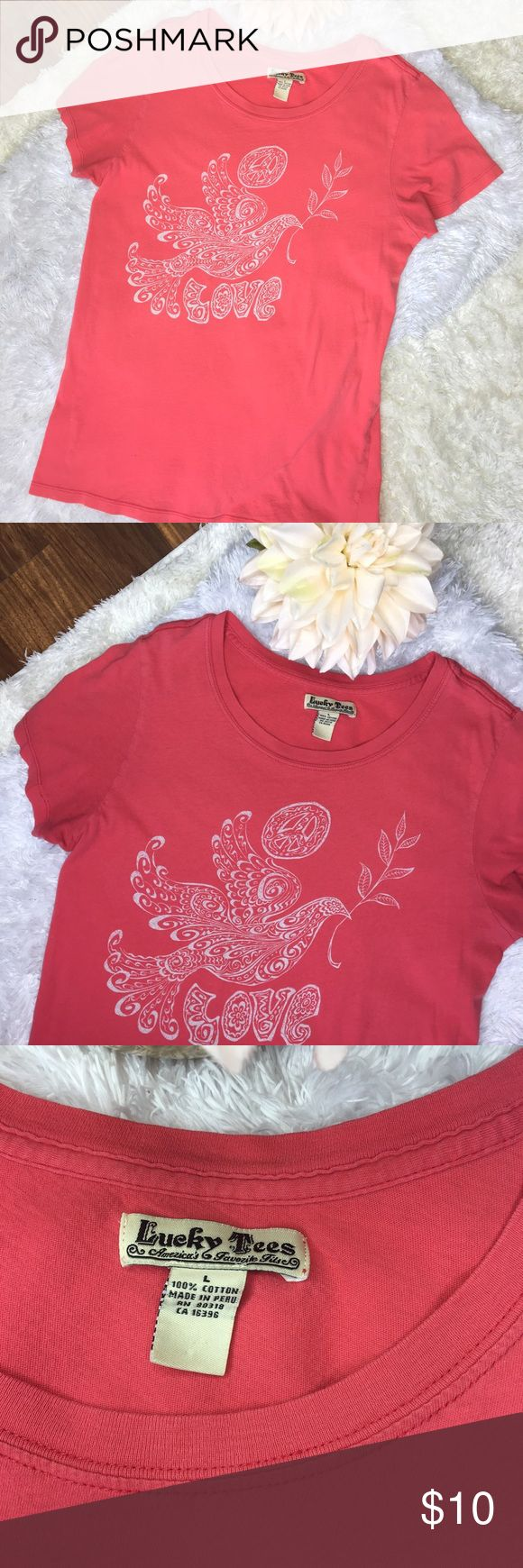 """Lucky Tees dark coral graphic short sleeve t shirt Lucky Tees coral graphic short sleeve tee shirt. Size Large. Cute dove, peace, flower graphic in white. Classic crew neck. Small discoloration spot on back seen in last photo. Approx measurements laying flat: 17.5"""" chest 25.5"""" length #lucky #tees #coral #graphic #peace #bird #love #flower #shortsleeve #top #shirt  ❌No trades❌ lucky tees Tops Tees - Short Sleeve"""