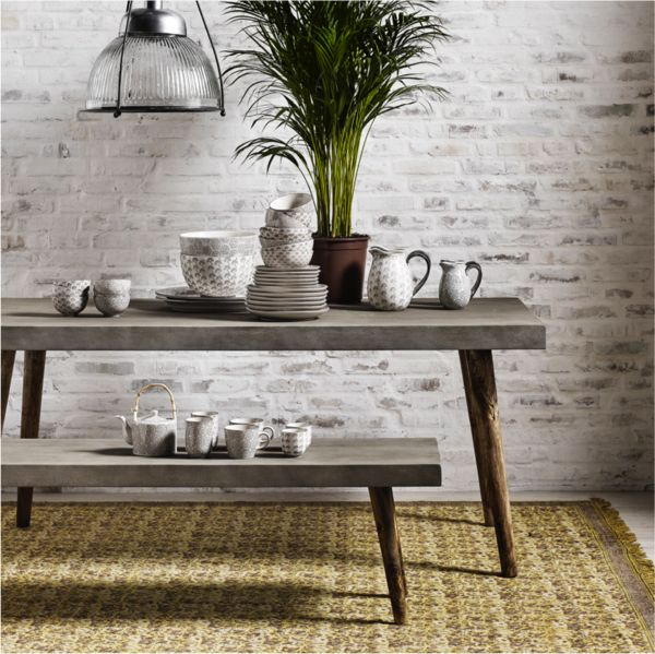 DESCRIPTION PRODUCT DETAILS Classically urban and perenniallycool! Our concrete dining set rocks. Use the bench with the table, or as a chic addition to a hall