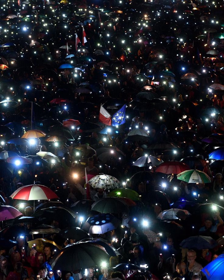 "People take part in a ""Chain of Light"" protest at Kasprowicza Square in Poznan, Poland, on July 24. Earlier in the day, in a surprise move, President Andrzej Duda vetoed two laws that would have given lawmakers wide-ranging powers over the judiciary. The bills drew fierce criticism from the E.U. and widespread protests over fears the government was eroding democratic norms of the rule of law and judicial independence.⠀ ⠀ Duda's unexpected intervention deals a blow to his right-wing Law and…"