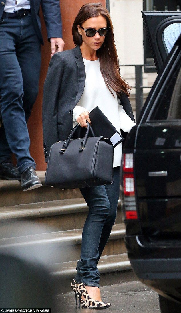 Victoria Beckham (with Victoria Beckham bag and Manolo Blahnik shoes) - Checked on the progress of her new Mayfair store, Dover Street in London.  (August 2014)
