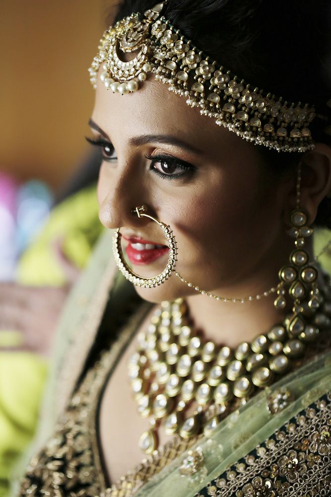 Real Indian Weddings - Sonika and Miten | WedMeGood | Beautiful Bride Sonika Wearing a Gold and Pearl Mathapatti with a Pearl Hanging Maang Tikka with a Polki Set and Matching Nath  Picture Courtesy: Model Studio #wedmegood #maathapatti #realwedding #jewelry