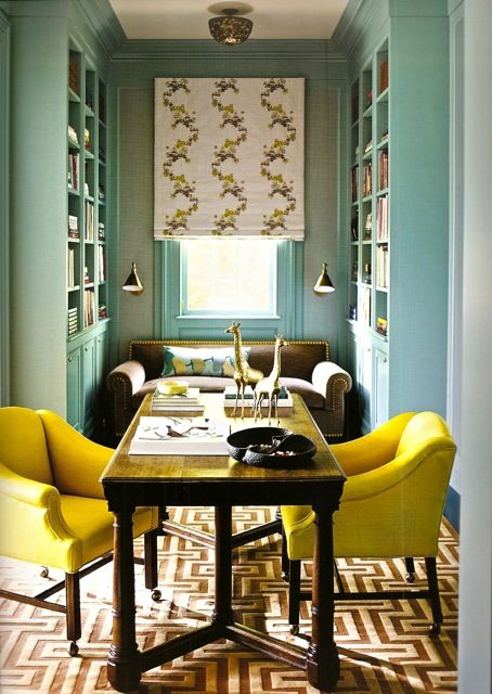 Katie Ridder. This is bluer in person. It's Farrow and Ball's Ballroom Blue. Two toned butterscotch carpet. Brass wall sconses and nail heads on sofa. That's yellow leather on chairs. Chinese inspired embroidery on the curtain and a kimona covered pillow on the sofa.