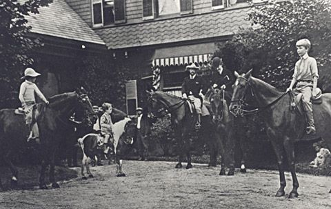 Theodore and Edith Roosevelt prepare to go riding with their sons, Archie, Kermit, and Quentin