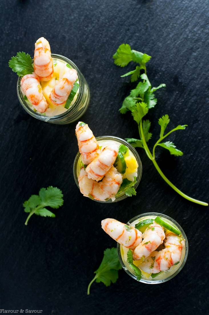This Paleo Grilled Prawn Cocktail with Pineapple Jicama Salad combines juicy pineapple, crisp cucumber and jicama with a tangy cilantro lime dressing. Top with fresh grilled prawns or shrimp for a spectacular mini appetizer.