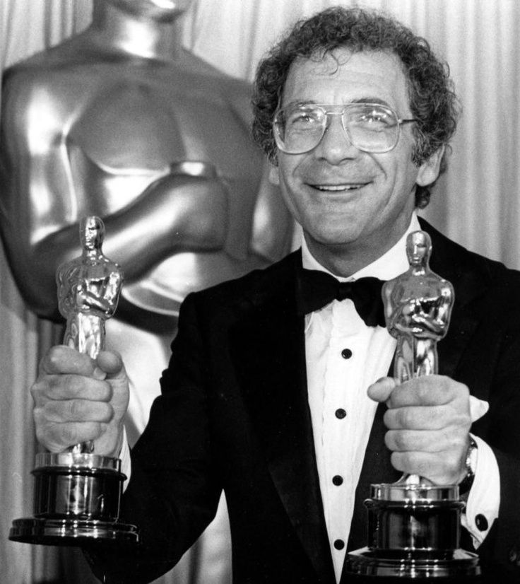 """Sydney Pollack clutches two Oscar statuettes for the movie """"Out of Africa"""""""