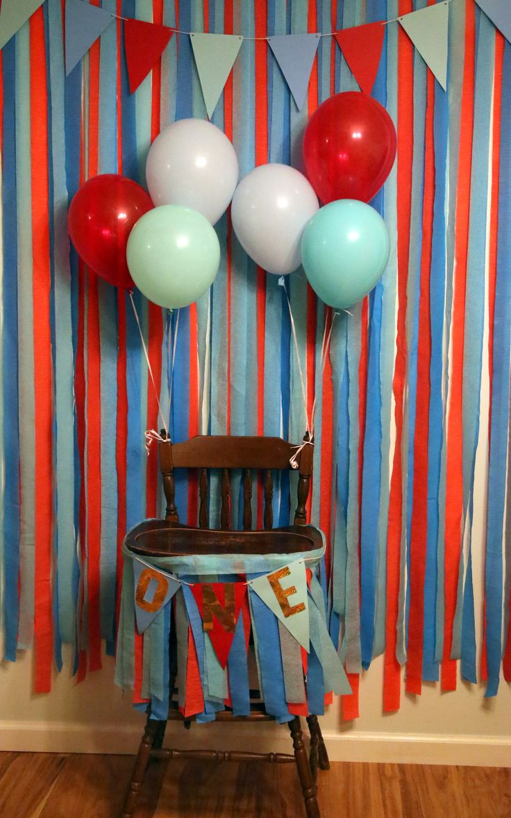 Boy's first birthday party decorations. Highchair