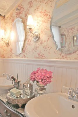 White and silver against the dark antiqued wood. Toile wallpaper. Touches of pink.