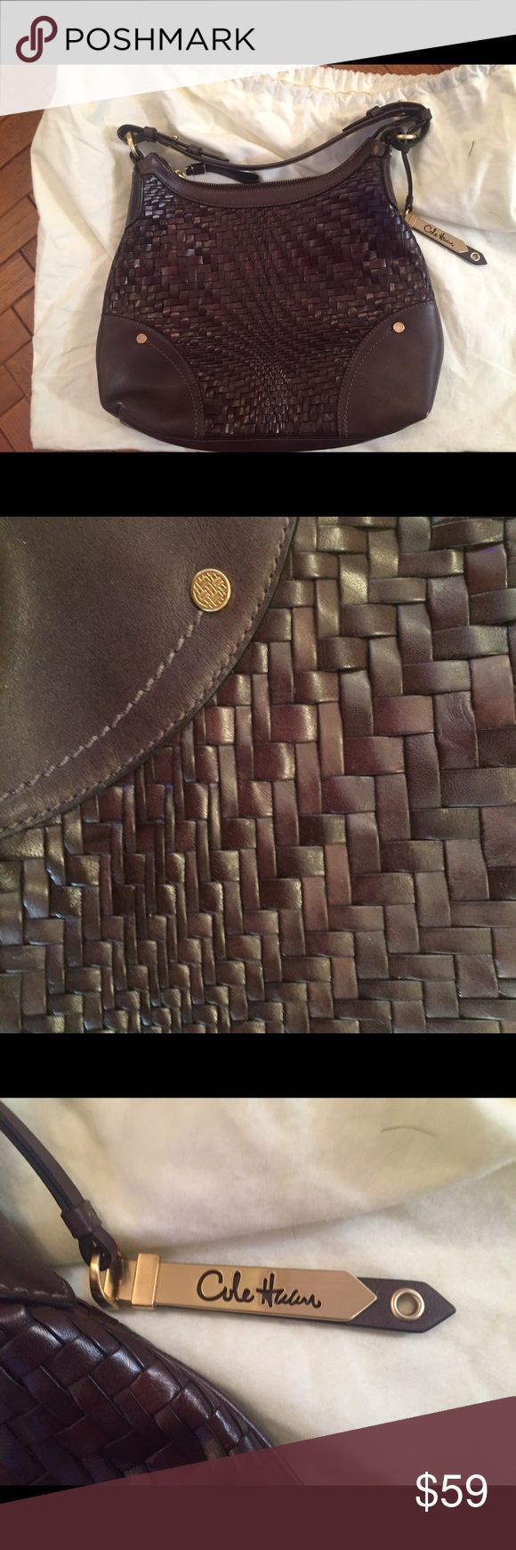 """Cole Haan Brown Leather Basket Weave Handbag Cole Haan brown leather basket weave handbag that I have not used.  You can tell by the pristine nature of the lining & the picture that shows the plastic wasn't even removed from the hardware on the center pocket zipper!  Was a sample model in the store.  As such, three of the corners have brown color rubbed off the leather (see pic) but the leather is still perfect so only needs to be polished on those corners.  13"""" across at widest/11"""" high at…"""