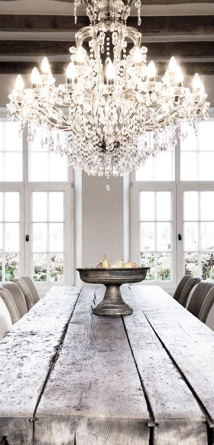Contrasting crystal lighting with rustic furniture.