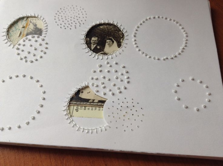 I've kept to a simple colour pallet of white, green blue and used cut away circles to reveal pictures underneath
