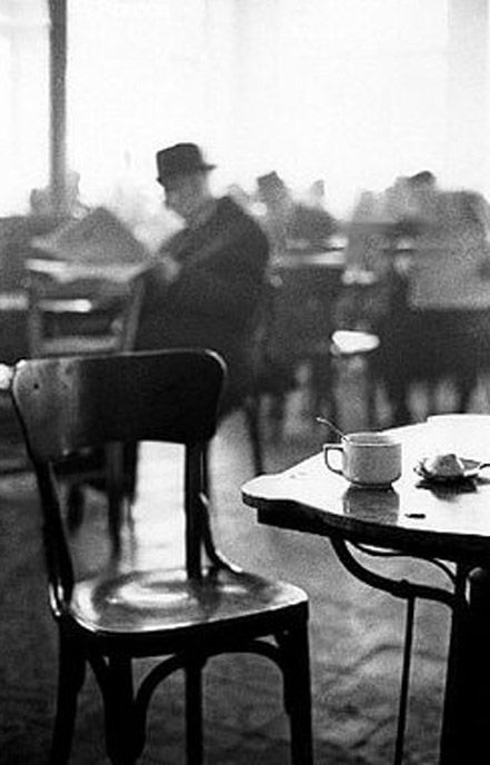 A cafe in Kalamata, Greece (1966) by Elliott Erwitt  Elliot is using Depth of Field in this picture.