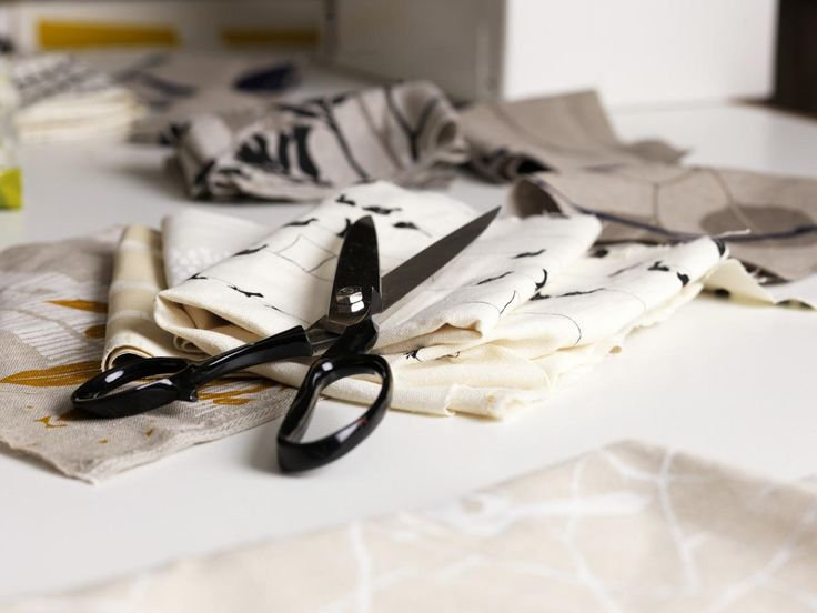 Photographed by Elke Meitzel - I really like the close up of the scissors sitting on top of the material