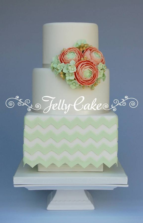 Mint green chevrons with pale peach sugar ranunculus with green hydrangeas and berries. This was one of the cakes I made for the Wedding Cake Showroom at the recent Squires Kitchen Exhibition in the UK.