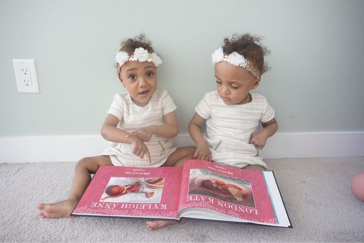 Showing My girls their nicu birth pics from when they were born premature at 26weeks.