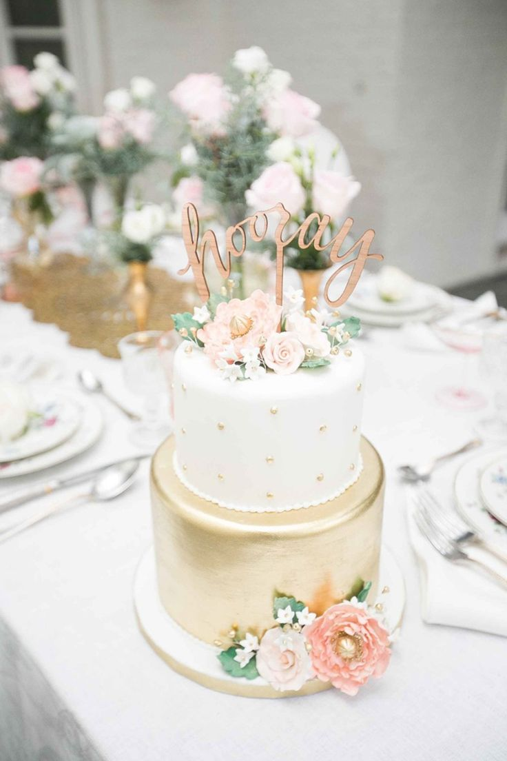 20. Hooray! This gold and white cake  is truly beautiful and chic in every way from The Frosted Affair, and if you think this cake is pretty, wait till you see the wedding here beautifully captured by Lindsey Grace.