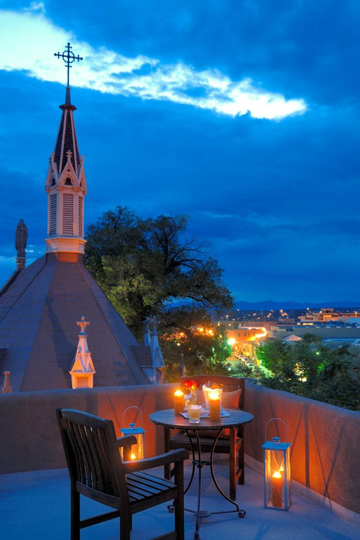 Santa Fe, New Mexico at night. Is that the cathedral? Is this on top of La Fonda?