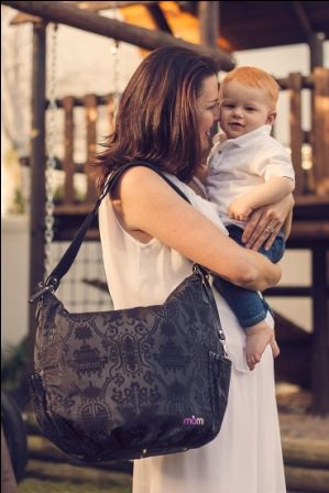 """This stylish """"Oh-Baby!"""" nappy bag includes a padded changing mat, has plenty of room for wipes, creams, change of clothes, extra nappies as well as your purse and other items.  It also has stroller straps so you can clip it to your pram!"""