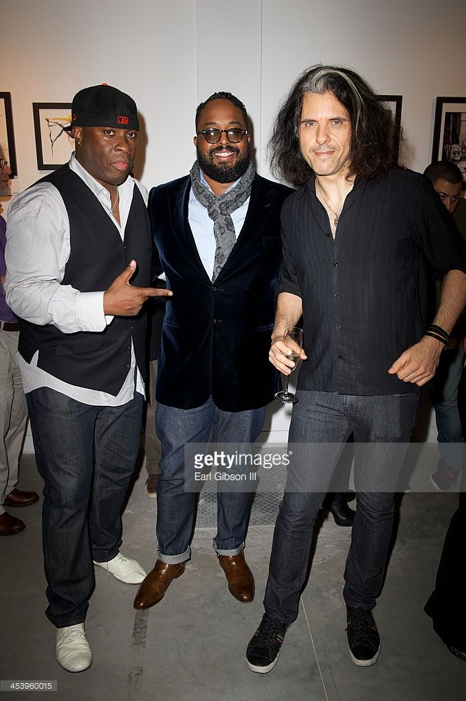 Vince Wilburn Jr., (nephew of Miles Davis), Erin Davis (son of Miles Davis) and Alex Skolnick (guitarist) attend the 'Miles Davis: The Collected Artwork' Holiday Pop-Up Gallery at Gallery 151 on December 5, 2013 in New York City.