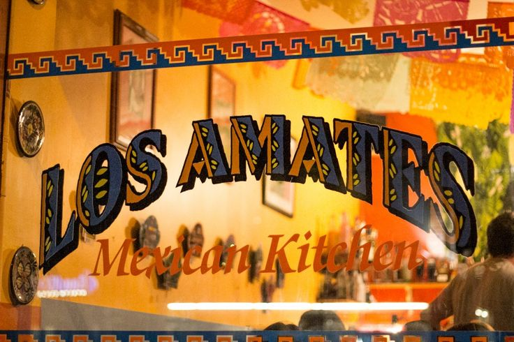 These paintings are featured on the restaurant's walls. When Arturo started the restaurant, he wanted a name that had meaning for him, referencing Amates that depict traditional cooking techniques, such as making tortillas.