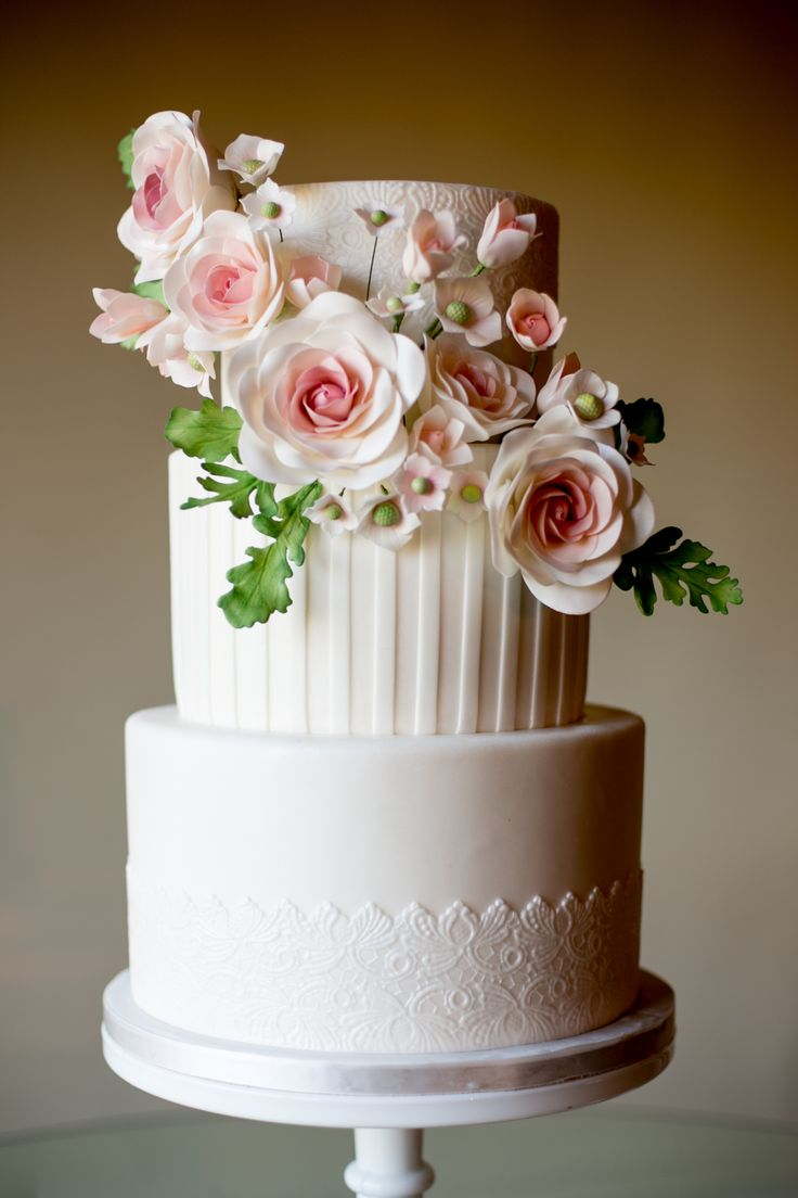 This cake with florals is everything!! View the full wedding here: http://thedailywedding.com/2016/01/17/luminous-winer-wedding-aleth-ryan/