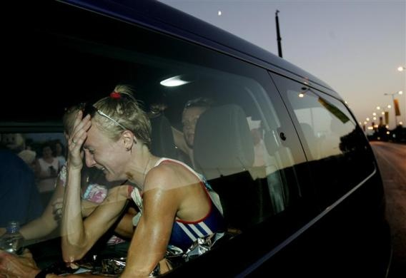 Britain's Paula Radcliffe cries in a vehicle after retiring from the women's Marathon in the Athens 2004 Olympic Games August 22, 2004.   REUTERS/Yannis Behrakis