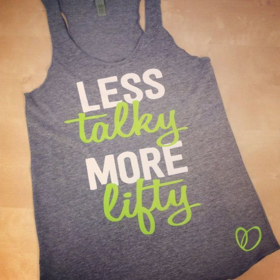 Less Talky More Lifty    Size: S-XL    Color: Grey eco-tank printed with White and Lime lettering.    FIT: Our eco-tanks do run short in