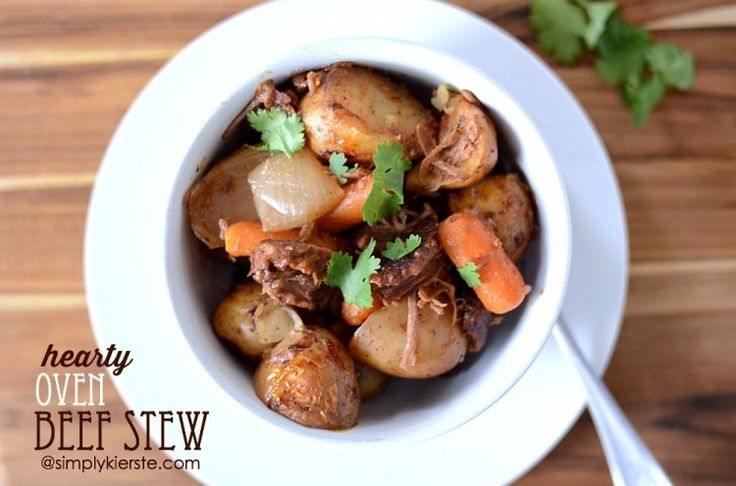 A Hearty Oven Beef Stew, thick with chunks and meat and vegetables, and slowly roasted all day to perfection! SO easy to put together!