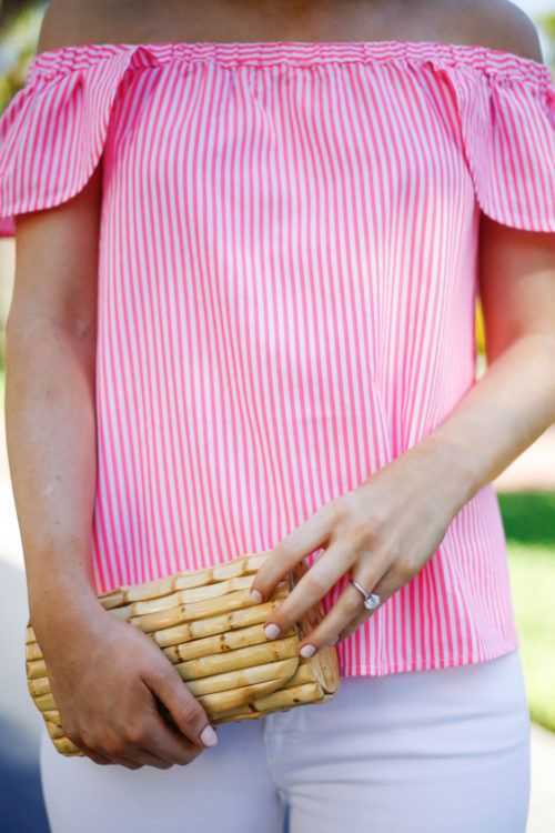 Pink seersucker top and bamboo clutch.