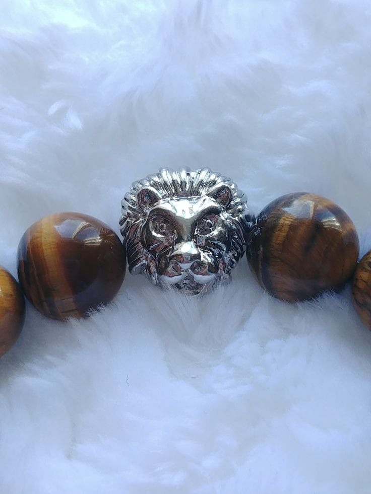 Tiger eye bracelet with lion head on Etsy from shop BracebyPatti