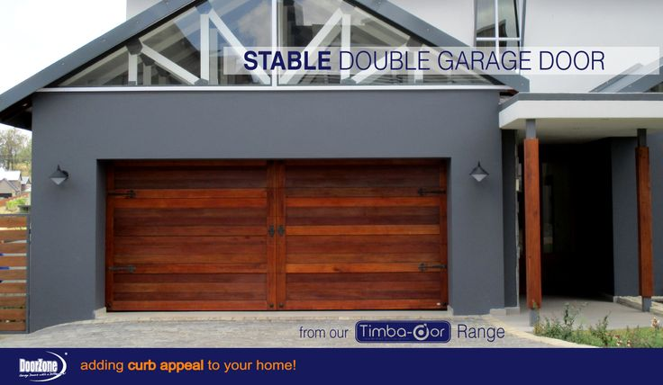 A Stable double Garage Door was chosen for this contemporary Style home. www.doorzonesa.com