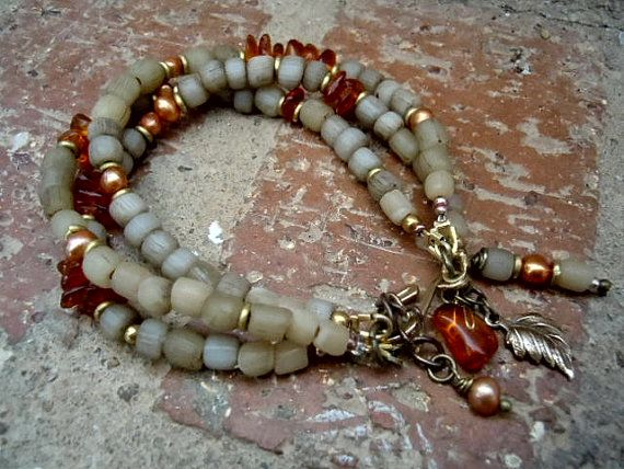 This three strand, free-spirited, bracelet combines handcrafted indonesian beads in earthy muted ivory tones, irregular baltic amber pieces radiating