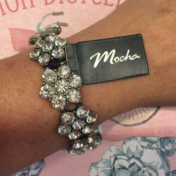 Ladies bracelet by Mocha Ladies Cz and silver colored accent bracelet u the brand Mocha. It stretches to fit most size wrists. I wear a 7 inch bracelet Mocha Jewelry Bracelets