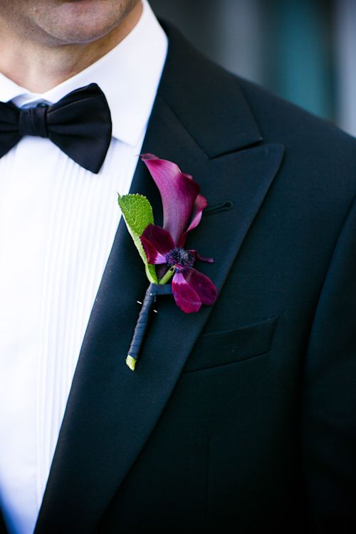 A lovely, formal purple boutonniere by LA's Seed Floral.  Photo by Callaway Gable | junebugweddings.com