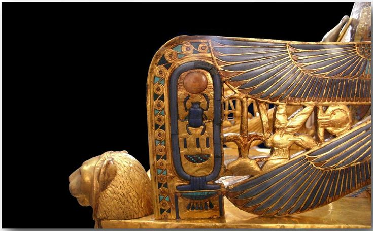 an Egyptian statue lying on its side in the orange sound - Google Search