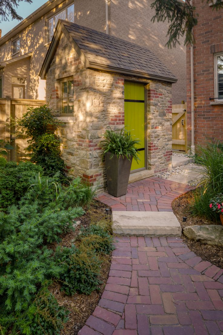 Beautiful brick path leading to a stunning stone change room/toilet. #brick #outdoor #landscaping