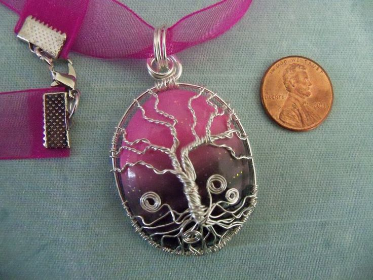 I called this one FL sunset - handmade polymer clay cabochon with a tree of life encasing it