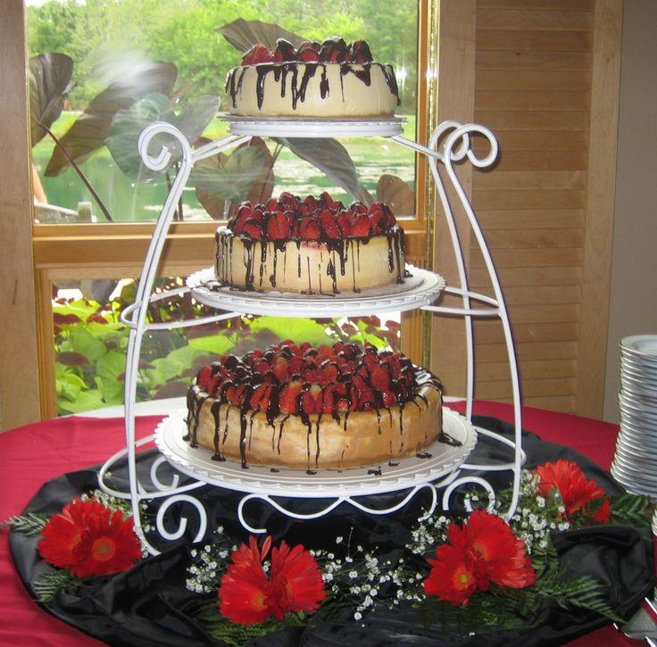 Cheesecake wedding cake. Possible different tiers: chocolate, cheesecake, tiramisu?     yep. this is right up my alley.