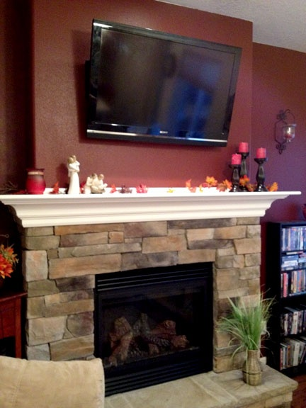 Our new fireplace, with rock masonry and a beautiful mantle!