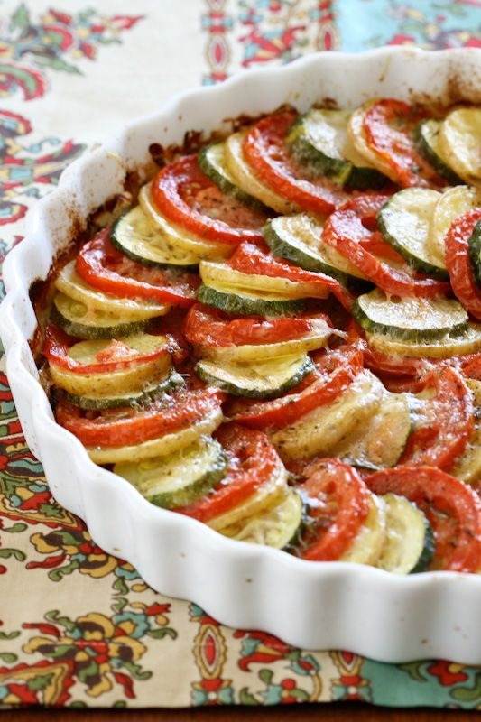 Vegetable Tian. Made with thinly sliced tomatoes, zuchini, onions and potatoes. Brushed with olive oil, spiced with tyme, salt, pepper and with a bit of chopped garlic, then sprinkled with romano or gouda grated cheese. Baked at 375, with foil for 30 minutes, and then without for 25. :) Sounds delicious.