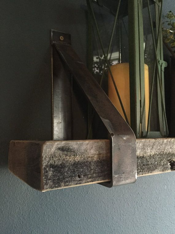 A set of industrial strap metal shelf brackets. Set includes 2 brackets. Please email with inquiries. The brackets do not include the barnwood. Complete shelves can be purchased at our store.