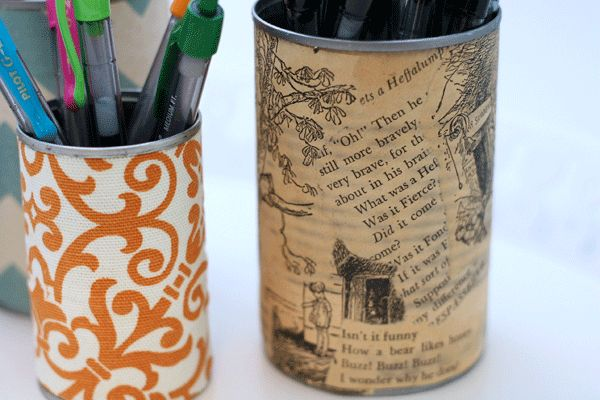 Upcycled DIY pencil holders covered with fabric or old book pages (my favorite) and homemade mod podge. Quick, easy, and charming.