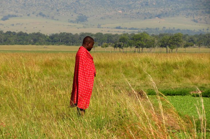 One of the Masai drivers at the edge of a hippo pool.