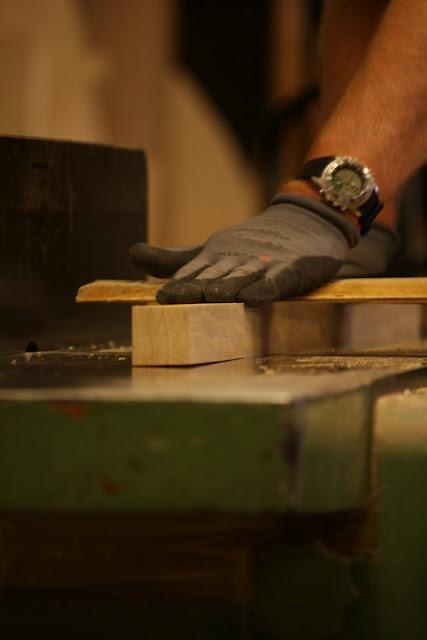 "Sticks for our coathanger ""skyline"". Bruno working at the workshop."