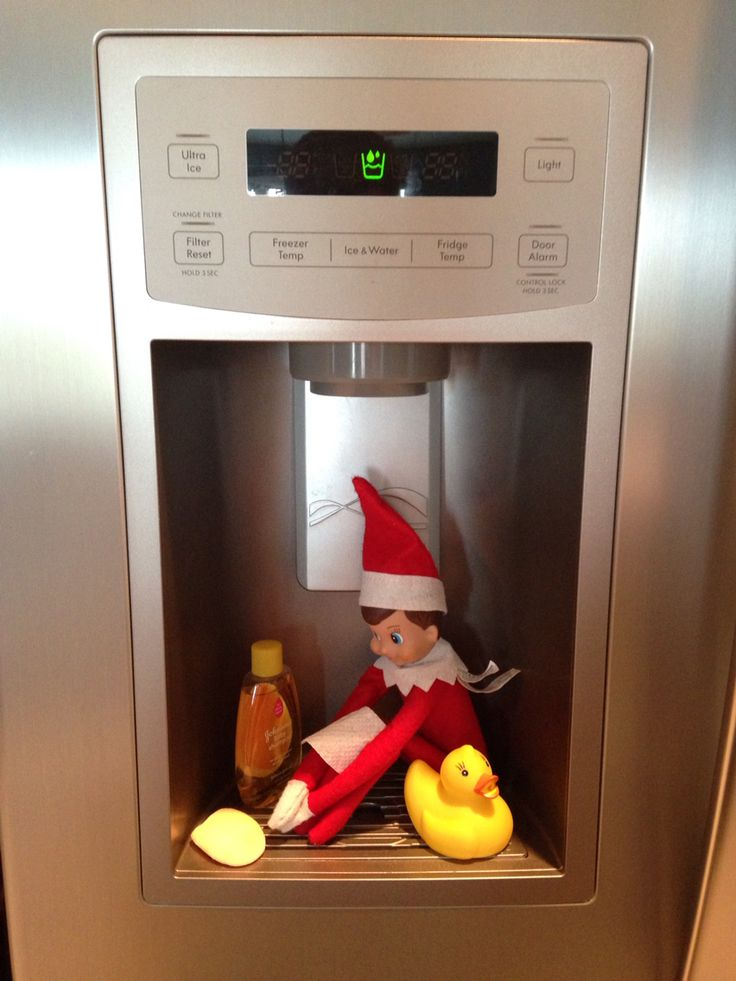 OK, as far as I can tell from Google and Pinterest searches, this is an original Elf on a Shelf idea I came up with! Taking a shower in the refrigerator water/ice dispenser.