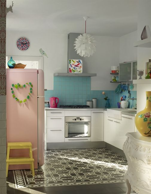 Colour accents can go a long way. Lovely kitchen.